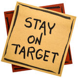 Stay on target reminder note. Stay on target - handwriting in black ink on an isolated sticky note Stock Photography