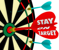 Stay on Target Words Dart Board Focus Goal Mission Achieved. Stay on Target words on a dart board to illustrate keeping your focus on the mission, objective or Royalty Free Stock Images