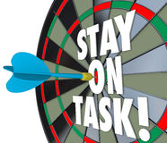 Stay on Task 3d Words Dart Board Complete Job. Stay on Task 3d words on a dart board to illustrate being diligent and completing a job, project or work Royalty Free Stock Image