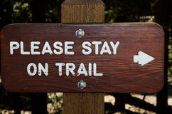 Stay on the trail sign. Sign requiring hikers to stay on the trail Royalty Free Stock Image