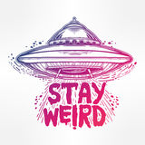 Stay weird. Inspirational quote with UFO. Stay weird. Hand drawn lettering inspirational quote.  vector illustration Royalty Free Stock Image