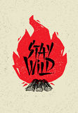 Stay Wild Creative Adventure Motivation Quote. Camping Fire Outdoor Adventure Banner Design Stock Photography