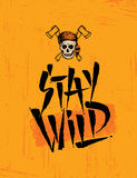 Stay Wild Skull Wearing Coonskin Hat With Two Crossed Axses Illustration On Rough Grunge Background. Stock Photography