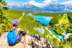 Free Staycation Hiker On Top Of Mountain Overlooking Local Town Of Canmore And Kananaskis Stock Image - 193233651