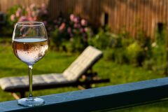 Staycation with rosé wine with deck chair at golden hour