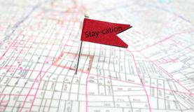 Staycation. Stay-cation flag pin on a map - local vacation concept royalty free stock images