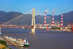 Stayed-cable bridge  and boatyard Royalty Free Stock Photos