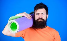 Staying flexible. Athlete yoga coach motivated for training. Yoga class concept. Yoga as hobby and sport. Practicing. Yoga every day. Man bearded athlete hold stock photography