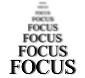 Staying in Focus. The word focus with blurred words in background isolated on white as concept for business ideas Stock Photography