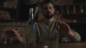 Close up of bearded man showing refusal from alcohol stock video