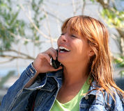 Staying in Touch. Middle aged woman enjoying her cell phone conversation Royalty Free Stock Photo