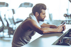 Staying in touch at gym. Stock Photography