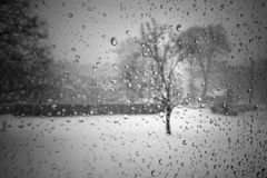 Staying warm during blizzard. During a nor`easter blizzard stay home for safety and warmth, a view through the window Royalty Free Stock Photography