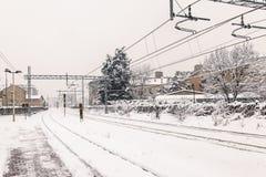 Stazione ferroviaria coperta da neve Fotografia Stock Libera da Diritti