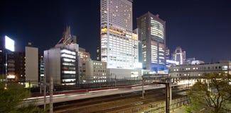 Stazione ferroviaria della città di Tokyo alla notte Immagine Stock
