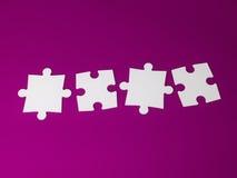 Stücke eines Puzzlespiels Lizenzfreie Stockbilder