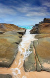 Steadfast,  Sea wash through rock crevice Stock Image