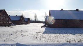 Steadicam shot of concentration camp barracks in winter. 4K video. Steadicam shot of concentration camp barracks in winter. 4K clip stock video