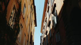 Steadicam shot: A cozy narrow street in the old historical part of Rome. stock footage