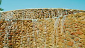 Steadicam shot: Decorative waterfall. Landscaping of houses and hotels stock video