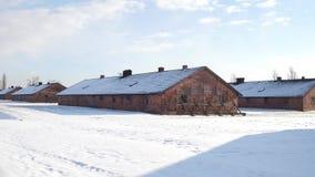 Steadicam shot of old concentration camp brick barracks in winter. 4K video. Steadicam shot of old concentration camp brick barracks in winter. 4K clip stock video