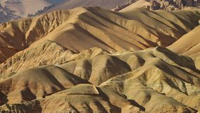 Dunes of sand and hills of argil. A steady, aerial, wide shot of dunes of sand and hills of argil during the sunny day stock video footage