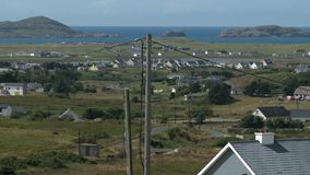 Small Neighborhood Near Large Body Of Water. Steady, aerial, wide shot of a small neighborhood next to a large body of water and islands stock footage