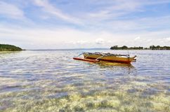 Steady boat on a calm sea. A boat freely floating on a calm sea nearby the resort in Olango Island, on a low tide, the area is not that deep though but you will royalty free stock photography