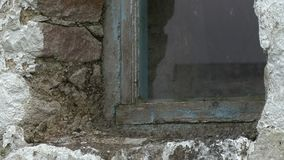 Window In Stone Building. Steady, close up shot of a window built into a stone building stock video