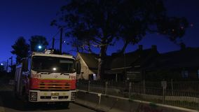 A parked fire truck. A steady full shot of a fire truck parked in the road stock video footage