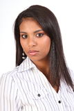 Steady gaze from beautiful young business woman. Headshot of beautiful young business woman wearing white button top with a cool gaze into camera Stock Photo