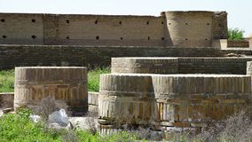 Fortress and brick cylinders. Steady, medium wide shot of brick cylinders next to a defensive wall stock footage