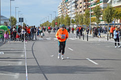A Steady Runner. A contestant in the Santa Pola Marathon happy to take things steady Royalty Free Stock Photography