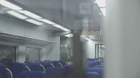Steady Shoot internal of a Regional Passenger Empty Train with Blue Seats. stock video
