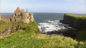 A castle beside a coastline. A steady shot of a castle and a coastline in Ireland stock footage