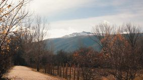 Steady Shot of Hiking Path with Snowed Mountain on the Background stock video footage