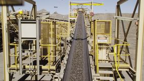 A gravel machine at work. A steady shot of a machinery that transports gravel. The shot is taken under a shining sun stock video footage