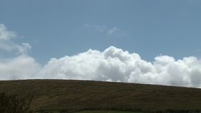 Clouds Peaking Over Hill