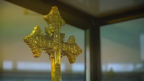 Two old golden crowns. A steady, wide shot of a display with two antique, golden crowns, with beautifully carved details stock footage