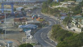 The highway beside a cargo place. A steady wide shot of a highway beside a cargo transport place stock video footage