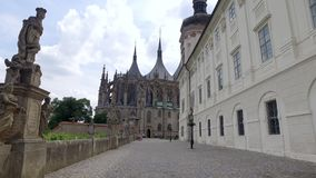 Steadycam shot in street in Kutna Hora town in summertime, Barbara church is in front