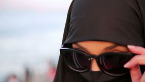 Steadycam - Woman with chador, hijab wearing sunglasses, istanbul stock video
