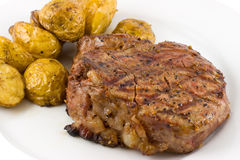 Steak 2. Closeup of grilled tenderloin steak with baby potatoes on plate stock images