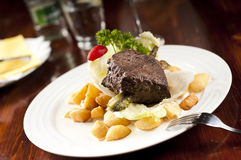 Steak. Beef steak with sauce and potatoes royalty free stock photography