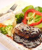 The Steak. Steak with pepper sauce and vegetable Stock Images