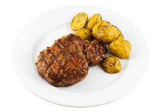 Steak. Grilled tenderloin steak with baby potatoes on plate royalty free stock image