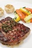 Steak. Western-style steak restaurant on yellow disk Stock Photography