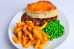 Steak and Ale pie. With Chips stock photography