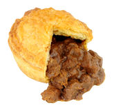 Steak And Ale Pie. Chunky steak and ale meat filled pie isolated on a white background Stock Photos