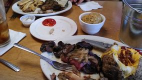 Steak and all the extra side dishes rice potatoes fries. Steak topping with mushrooms onions peanuts food table Stock Photo